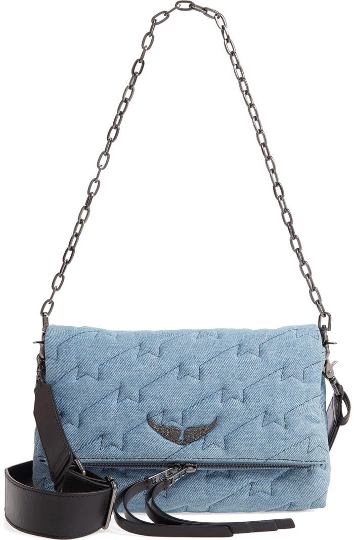 Vintage-wash denim textured with lightning-bolt quilting brings a touch of rock 'n' roll edge to a versatile bag finished with signature metal wings